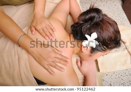 Body massaging, part of spa treatment. - stock photo