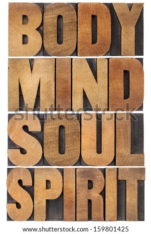 body, mind, soul and spirit typography - a collage of isolated words in vintage wood letterpress type scaled to a rectangle