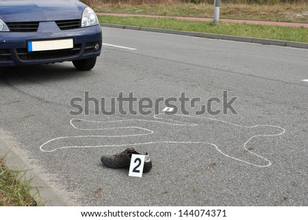 Body of a man on the street  hit by the car - stock photo