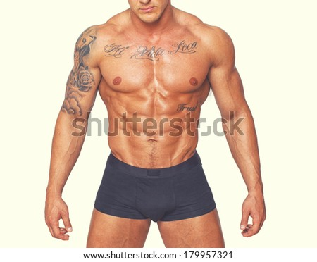 Body of a tattooed athlete in underpants - stock photo