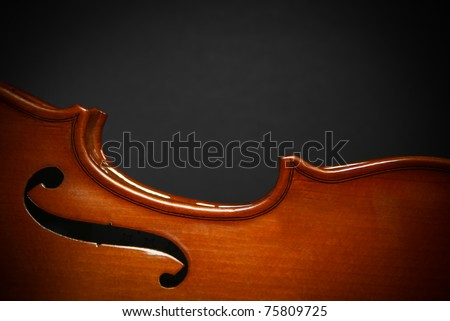 Body of a Violin, in the spotlight, isolated with a dark grey background. - stock photo