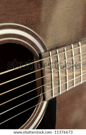 Body of an old acoustic guitar close up - stock photo