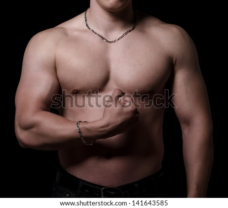 Body of bodybuilder isolated on black.