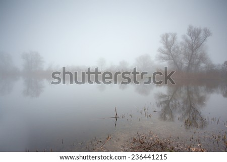 Body of water in the mist - stock photo