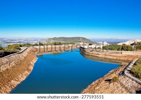 body of water near dam Tajo de la Encantada and Royal Trail (El Caminito del Rey) in gorge Chorro, Malaga province, Spain  - stock photo