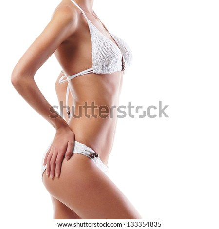 Body of young and beautiful woman isolated on white - stock photo
