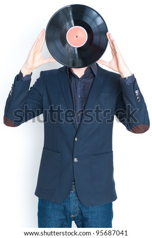 Body of young man in jacket covering face with LP record, isolated on white background. - stock photo