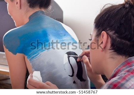 body-painting on girl's back (1) - stock photo