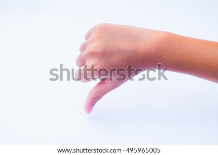 Body part, thumbs down over white background