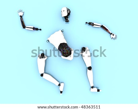 Body parts of a female robot lying spread out on the floor. - stock photo