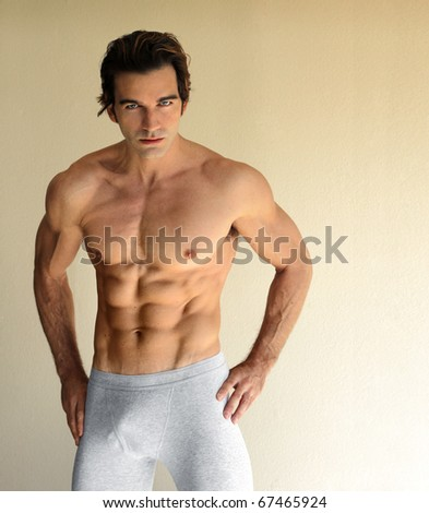 Body portrait of a sexy young man in boxer brief underwear - stock photo