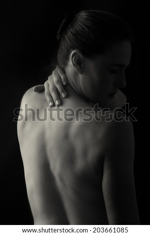 Body scape of woman back in low light with emotion artistic conversion