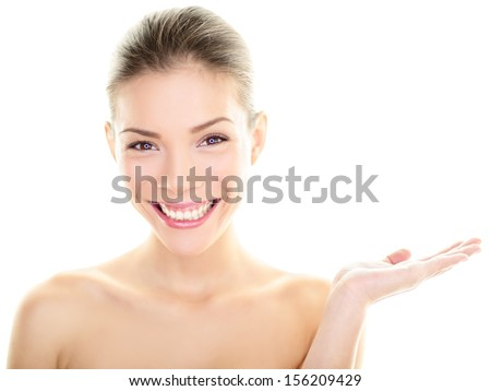 Body skincare care beauty Asian woman showing product on side with open hand. Healthy glowing skin on multi-ethnic Chinese / Caucasian girl presenting and displaying isolated on white background. - stock photo