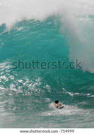 Body surfing in Hawaii - stock photo