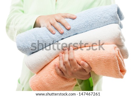 Body treatment and healthy lifestyle - beauty woman hand holding clean dry spa towels stack white isolated - stock photo
