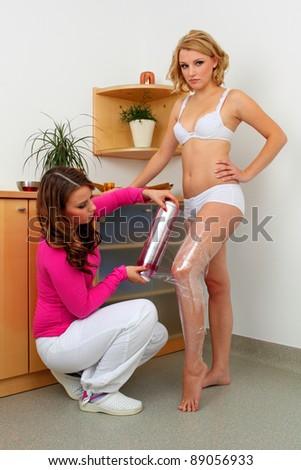Body wrapping. Anti-cellulite treatment. - stock photo