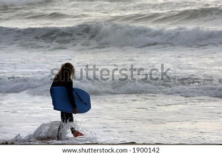 bodyboarder enter in the sea - stock photo