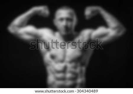 Bodybuilder. blurred Background - stock photo