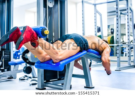 bodybuilder doing exercises on Leg - stock photo