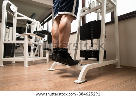 Bodybuilder Doing Heavy Weight Exercise For Legs Calves