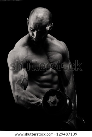 Bodybuilder exercising biceps curl.