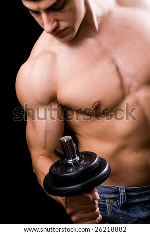 Bodybuilder in action - muscular powerful man lifting metal weights - stock photo