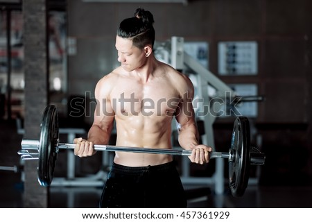 Bodybuilder in the gym club