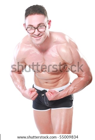 Bodybuilder nerd, shows muscle and is very happy. - stock photo