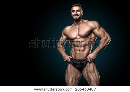 bodybuilder on a black background - stock photo