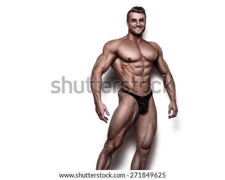 bodybuilder on white background - stock photo