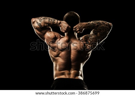 bodybuilder posing. Beautiful sporty guy male power. Fitness mus - stock photo