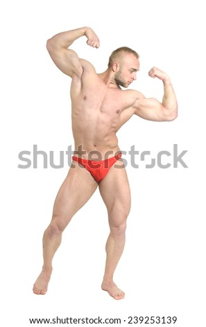 Bodybuilder posing his muscles on white background - stock photo