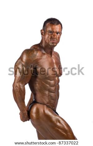 bodybuilder posing in a studio - stock photo