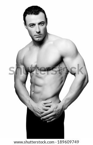 Bodybuilder posing, isolated on white background. - stock photo
