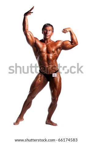 bodybuilder posing over white background - stock photo