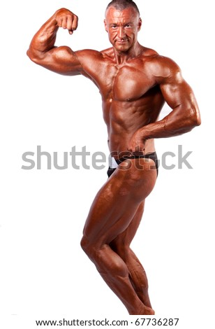 Bodybuilder posing over white background