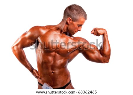 Bodybuilder posing ower white background