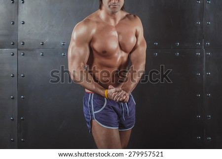 Bodybuilder posing Strong Athletic Man Fitness Model Torso showing big muscles fitness healthy lifestyle bodybuilding concept - stock photo