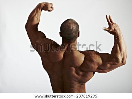 Bodybuilder showing arms & shoulders  - stock photo