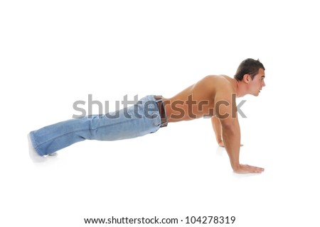 Bodybuilder showing his muscles does push-ups on the floor. Isolated on a white background - stock photo