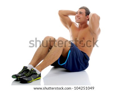 Bodybuilder showing his muscles perform exercises for abdominal muscles. Isolated on a white background - stock photo