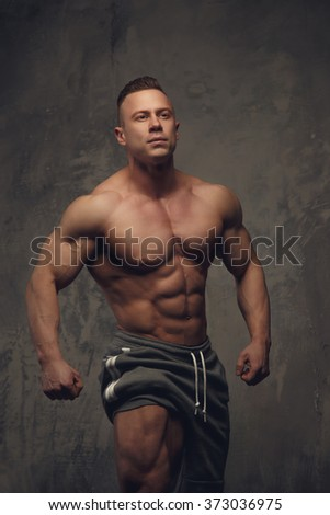 Bodybuilder showing his muscular torso.