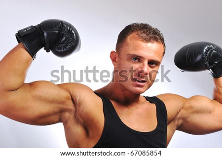 Bodybuilder strong as a rock, boxing, gloves, muscles