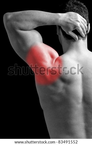 Bodybuilder suffering from shoulder pain. - stock photo