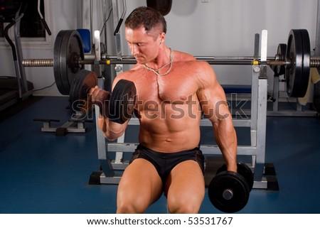 Bodybuilder training in the gym - stock photo