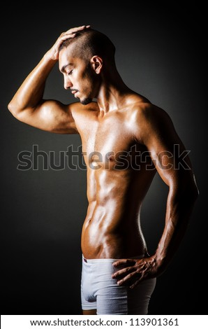 Bodybuilder with muscular body - stock photo