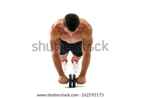 Bodybuilder working on his abs with a ab roller. Strong man with perfect abs, shoulders,biceps, triceps and chest. Isolated on white background - stock photo