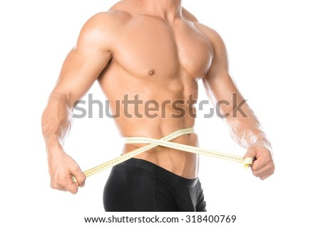 Bodybuilding and Sports theme: handsome strong bodybuilder holding centimeter tape to measure body isolated on white background in studio