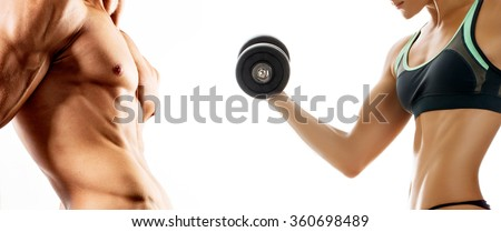Bodybuilding. Strong man and a woman posing on a white background - stock photo