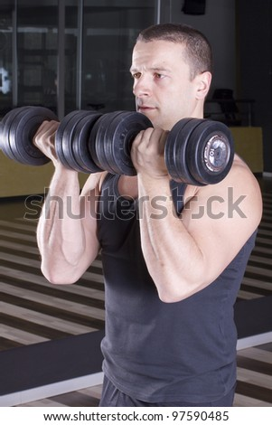 Bodybuilding with light weight weights - stock photo